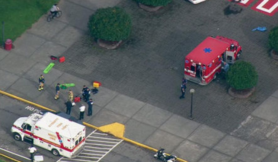 This image made from a video provided by KOMO shows emergency personnel responding after reports of a shooting at Marysville-Pilchuck High School in Marysville, Wash., Friday, Oct. 24, 2014. (AP Photo/KOMONews.com) MANDATORY CREDIT
