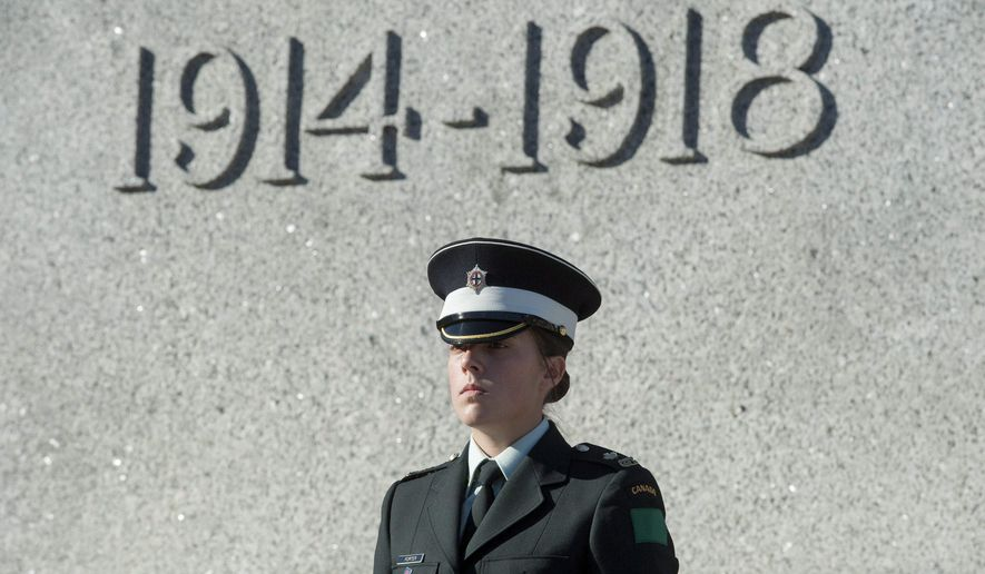A sentry guards the Tomb of the Unknown Soldier at the National War Memorial in Ottawa on Friday, Oct. 24, 2014. The sentries returned to their posts two days after Cpl. Nathan Cirillo, 24, a reservist from Hamilton, Ont., was killed while guarding the tomb by a gunman, who then moved to nearby Parliament Hill, opening fire before he himself was shot dead.  (AP Photo/The Canadian Press, Justin Tang)