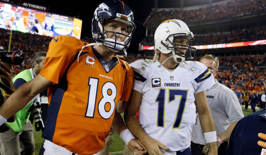 Denver Broncos quarterback Peyton Manning (18) greets San Diego Chargers quarterback Philip Rivers (17) after an NFL football game, Thursday, Oct. 23, 2014, in Denver. The Broncos won 35-21. (AP Photo/Jack Dempsey)