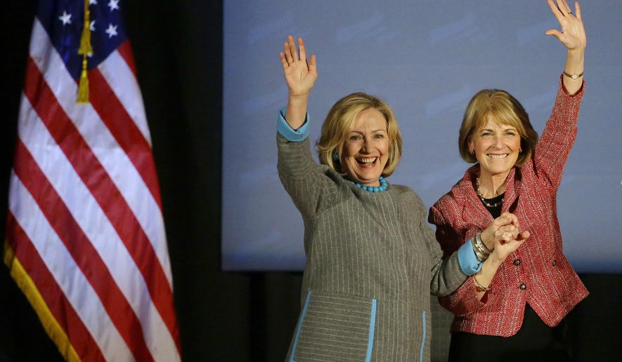 Former Secretary of State Hillary Rodham Clinton and Massachusetts Democratic gubernatorial candidate Martha Coakley wave during a Coakley campaign event at the Park Plaza Hotel in Boston, Thursday, Oct. 24, 2014. (AP Photo/Stephan Savoia)