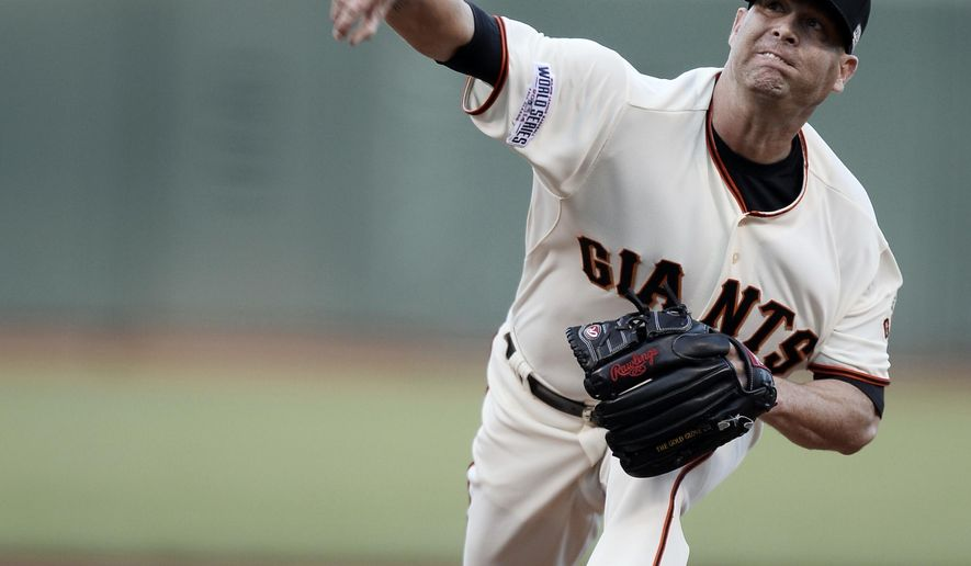 San Francisco Giants pitcher Tim Hudson throws during the first inning of Game 3 of baseball's World Series against the Kansas City Royals Friday, Oct. 24, 2014, in San Francisco. (AP Photo/Paul Buck, Pool)