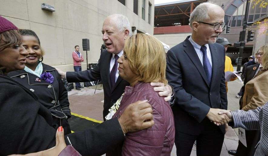 ADVANCE FOR USE SUNDAY OCT 24, 2014 AND THEREAFTER - FILE - In this Oct. 15, 2014 file photo, Illinois Gov. Pat Quinn and his lieutenant governor running mate Paul Vallas, right, speak with family members of gun violence victims, after a news conference in Chicago. Quinn and Vallas are running against Illinois Republican Bruce Rauner, and his running mate, Evelyn Sanguinetti. (AP Photo/M. Spencer Green,File)