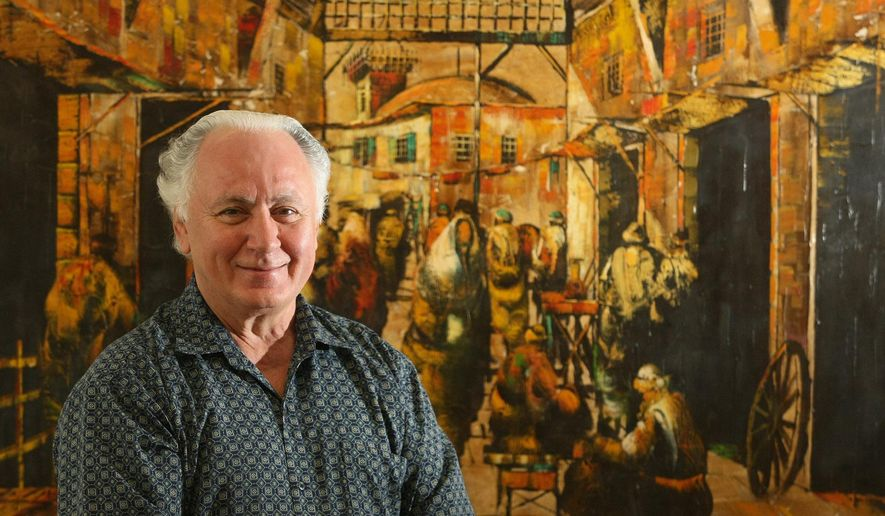 In this Sept., 2010 photo, Bill Aossey Jr. poses for a portrait in front of an image of Damascus, at Midamar Corp. in Cedar Rapids, Iowa. Iowa-based Midamar, which Aossey founded in 1974, is a leading U.S. halal company that sells beef, turkey, chicken and other products around the world. (AP Photo/The Des Moines Register, Mary Willie)