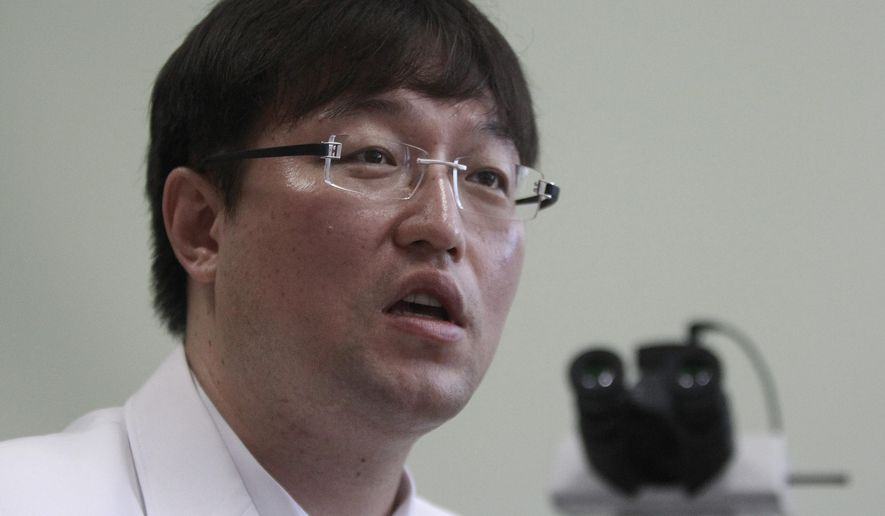 In this Sept. 5, 2014 photo,  Ryu Young-joon speaks during an interview at Kangwon National University Hospital in Cuncheon, South Korea. Ryu, the whistle-blower who exposed breakthrough cloning research as a devastating fake says South Korea is still dominated by the values that allowed science fraudster Hwang Woo-suk to become an almost untouchable national hero. (AP Photo/Joyce Lee)
