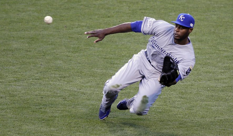 Kansas City Royals' Lorenzo Cain makes a diving catch on a ball hit by San Francisco Giants' Travis Ishikawa during the second inning of Game 3 of baseball's World Series Friday, Oct. 24, 2014, in San Francisco. (AP Photo/Eric Risberg)