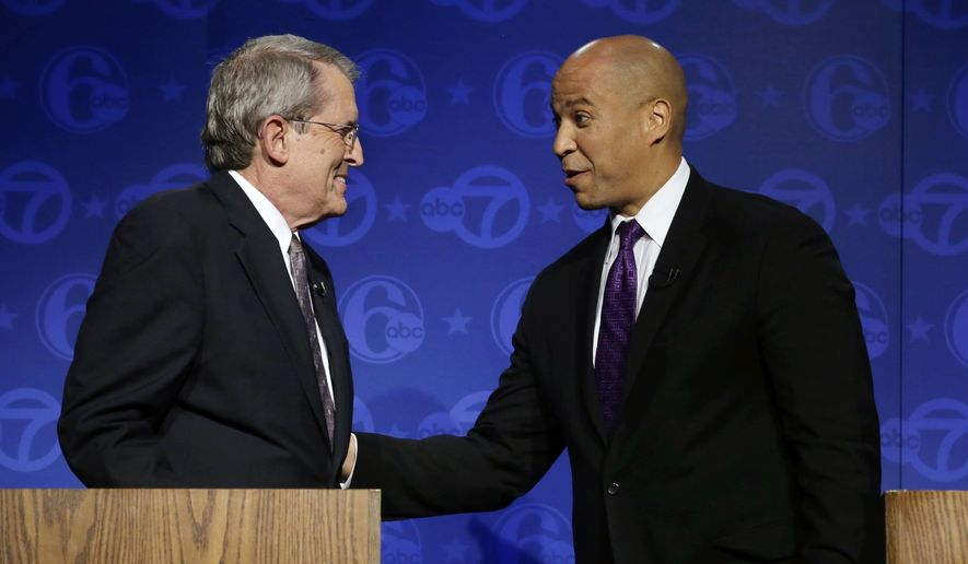 Republican candidate for Senate, Jeff Bell, left, and incumbent Democrat Cory Booker greet after their debate Friday, Oct. 24, 2014, in Trenton, N.J. New Jersey's U.S. Senate candidates participated in their first and only debate of the campaign and fielded questions at the League of Women Voters event. (AP Photo/Mel Evans)