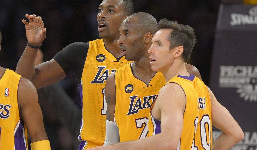 FILE - In this Feb. 22, 2013, file photo, Los Angeles Lakers center Dwight Howard, left, guard Kobe Bryant, center, and guard Steve Nash look on during the second half of their NBA basketball game against the Portland Trail Blazers in Los Angeles. Nash hoped for one more chance to show off his playmaking skills after fighting injuries and time for two miserable years with the Lakers. Instead, Nash couldn't even make it to opening night in the 19th season of his remarkable career. Nash will miss the entire season because of a back injury, the Lakers announced Thursday, Oct. 23, 2014, putting the two-time NBA MVP point guard's career in doubt. (AP Photo/Mark J. Terrill, File)