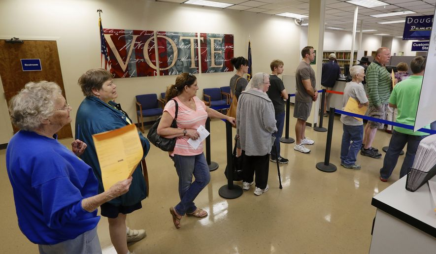 Early voters wait in line to get their ballots at the Douglas County Election Commission offices in Omaha, Neb., Friday, Oct. 24, 2014. Early voting numbers in Nebraska's 2nd Congressional District show that more than half of those cast their ballots early for the Nov. 4 general election have been Democrats, a fact that could play significantly into whether incumbent Republican Lee Terry wins a ninth term or whether he's knocked off by Democratic challenger Brad Ashford. (AP Photo/Nati Harnik)