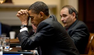 """President Obama appears in deep thought as he and senior adviser David Axelrod listen during a climate change meeting in the Roosevelt Room of the White House. A moment later, he was """"laughing at a humorous exchange."""" (Official White House photo by Pete Souza) **FILE**"""