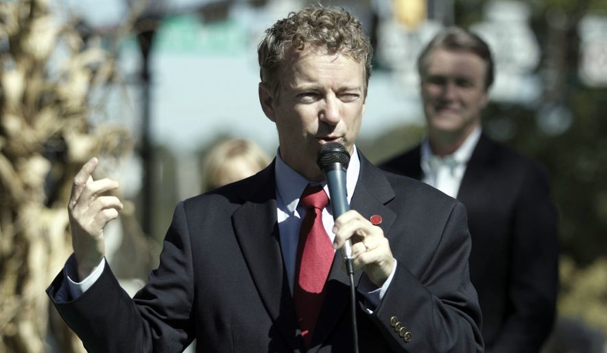 Kentucky Senator Rand Paul stumps for Georgia Republican candidate for U.S. Senate David Perdue at a rally at McDonough Square in Henry County Friday, Oct. 24, 2014. (AP Photo/Akili-Casundria Ramsess)