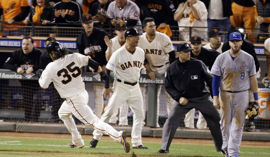 San Francisco Giants' Brandon Crawford heads for home on an RBI double by Giants' Michael Morse during the sixth inning of Game 3 of baseball's World Series against the Kansas City Royals on Friday, Oct. 24, 2014, in San Francisco. (AP Photo/Charlie Riedel)