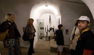 Benito Mussolini's first air raid shelter, created in old wine cellars, is seen during a visit for the press in Villa Torlonia in Rome, Saturday, Oct. 25, 2014. After the outbreak of World War II, the shelter was quickly constructed in 1940 in what had been the wine cellar of Torlonia noble family, who lived there before Mussolini took up residence during his Fascist rule. The city of Rome now owns the villa and opened the shelter to tourists with reservations starting from Oct. 31. (AP Photo/Andrew Medichini)
