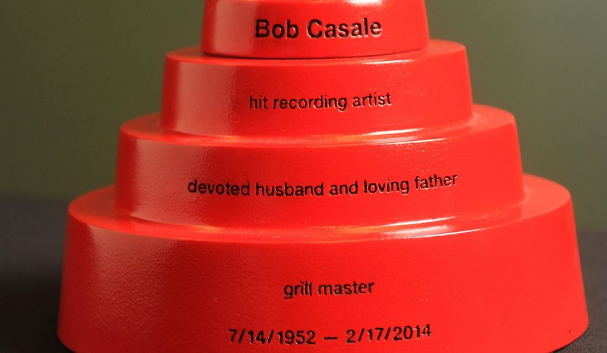 In this Oct. 23, 2014 photo, a composite ceramic custom printed 3-D funeral urn for Devo co-founder Bob Casale, depicts the hats worn by the band Devo, made by Foreverence, is seen in Eden Prairie, Minn. Foreverence sells the urns via funeral directors, The St. Paul Pioneer Press reported. (AP Photo/The St. Paul Pioneer Press, Scott Takushi)