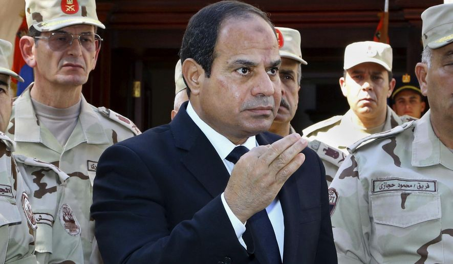 "In this photo provided by Egypt's state news agency MENA, Egyptian President Abdel-Fattah el-Sissi speaks in front of the state-run TV ahead of a military funeral for troops killed in an assault in the Sinai Peninsula, as he stands with army commanders in Cairo, Egypt, Saturday, Oct. 25, 2014. El-Sissi said the deadly assault on an army checkpoint in northern Sinai that killed at least 30 troops was a ""foreign-funded operation."" No group has yet claimed responsibility for the attack. (AP Photo/MENA, Mohammed Samaha)"