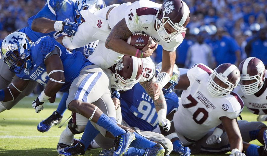 Mississippi State quarterback Dak Prescott dives into the end zone for a touchdown during the first half of an NCAA college football game against Kentucky at Commonwealth Stadium in Lexington, Ky., Saturday, Oct. 25, 2014. (AP Photo/David Stephenson)