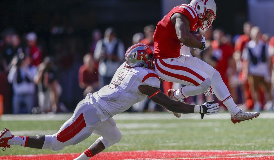 Nebraska running back Ameer Abdullah, right, tries to vault past Rutgers linebacker Steve Longa (3) in the first half of an NCAA college football game in Lincoln, Neb., Saturday, Oct. 25, 2014. (AP Photo/Nati Harnik)
