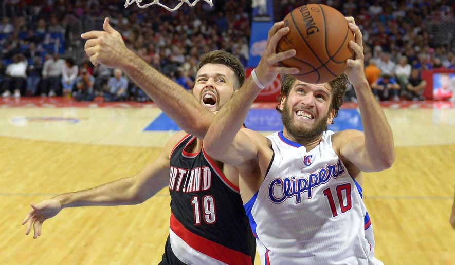 Los Angeles Clippers forward Spencer Hawes, right, goes to the basket as Portland Trail Blazers center Joel Freeland, of England, defends during the second half of a preseason NBA basketball game, Friday, Oct. 24, 2014, in Los Angeles. The Trail Blazers won 99-89. (AP Photo/Mark J. Terrill)