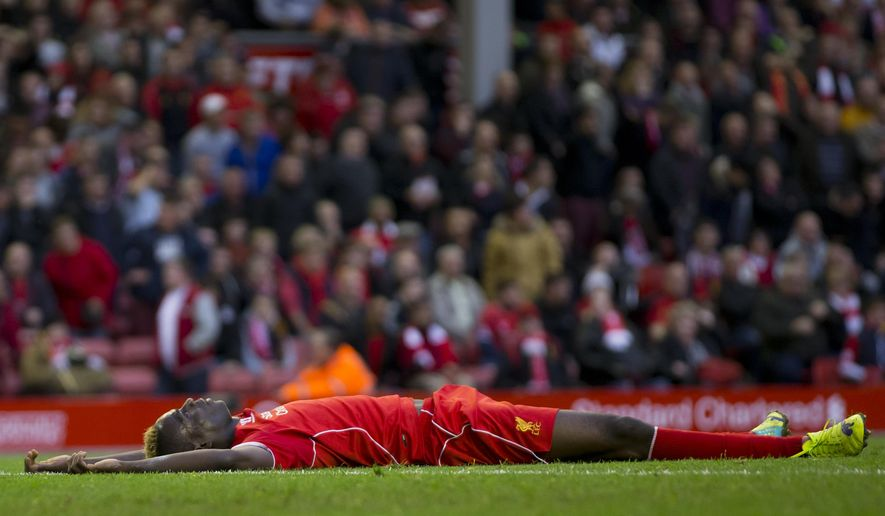Liverpool's Mario Balotelli reacts after a missed opportunity during his team's 0-0 draw against Hull, during their English Premier League soccer match at Anfield Stadium, Liverpool, England, Saturday Oct. 25, 2014. (AP Photo/Jon Super)