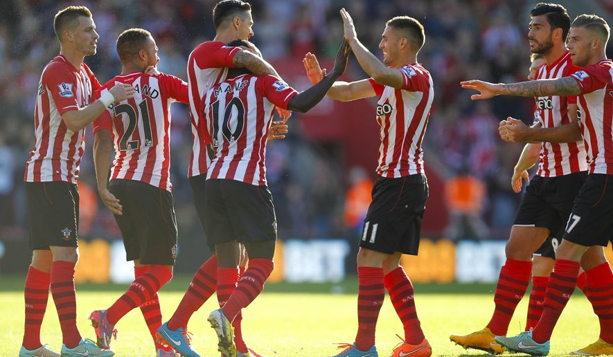 Southampton's Sadio Mane, center left, celebrates his goal with teammates during the English Premier League soccer match against Stoke City at St. Mary's Stadium, Southampton, England, Saturday, Oct. 25, 2014. (AP Photo/Chris Ison, PA Wire)     UNITED KINGDOM OUT    -   NO SALES    -    NO ARCHIVES