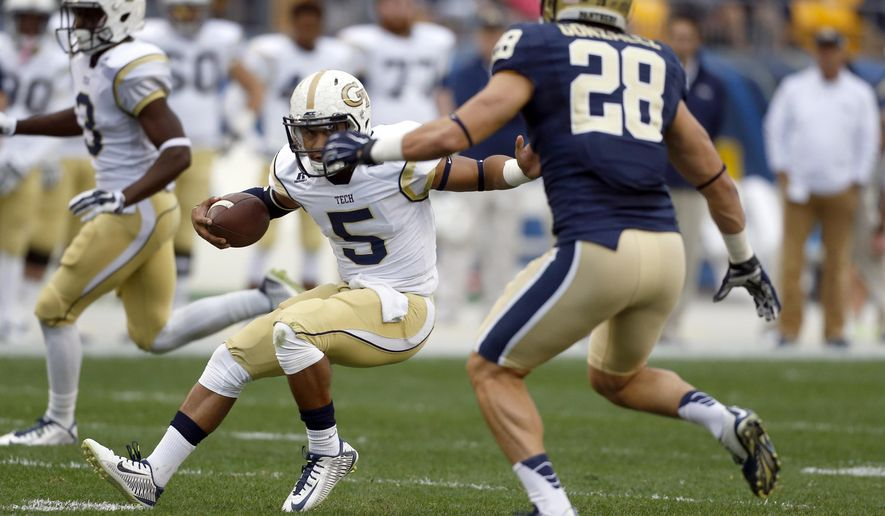 Georgia Tech quarterback Justin Thomas (5) tries to evade Pittsburgh linebacker Anthony Gonzalez (28) in the first quarter of an NCAA football game, Saturday, Oct. 25, 2014, in Pittsburgh. (AP Photo/Keith Srakocic)