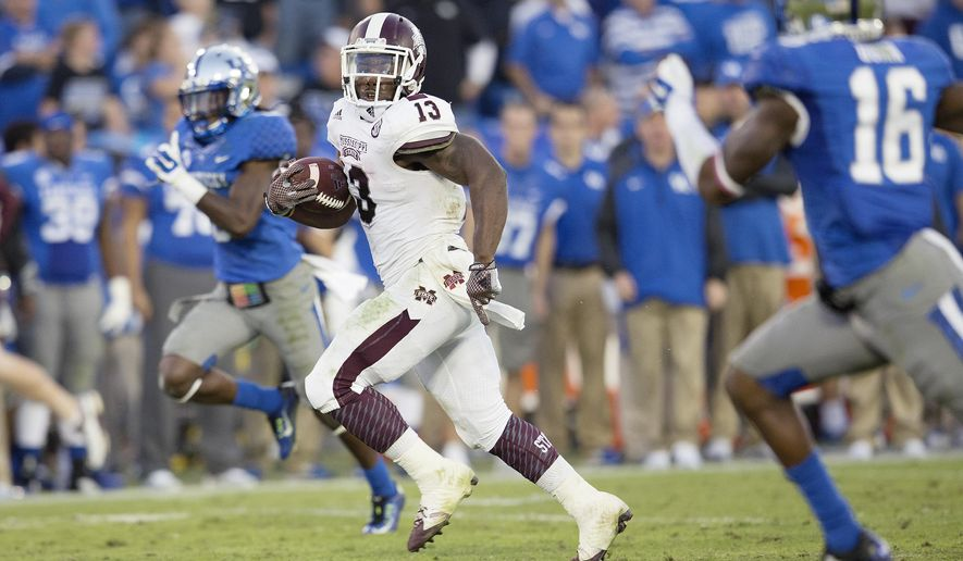 Mississippi State running back Josh Robinson breaks away from the Kentucky defense for a touchdown during the second half of an NCAA college football game in Lexington, Ky., Saturday, Oct. 25, 2014. Mississippi State won 45-31. (AP Photo/David Stephenson)