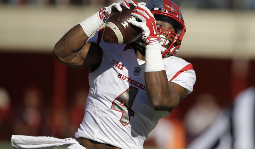Rutgers wide receiver Leonte Carroo (4) catches a pass from quarterback Gary Nova in the first half of an NCAA college football game against Nebraska in Lincoln, Neb., Saturday, Oct. 25, 2014. (AP Photo/Nati Harnik)