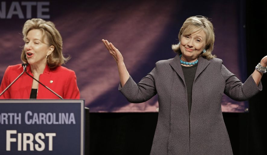 Sen. Kay Hagan (D-NC), left, speaks to supporters as former Secretary of State of State Hillary Rodham Clinton reacts during a campaign rally in Charlotte, N.C., Saturday, Oct. 25, 2014. Hagan is running for re-election against Republican candidate and North Carolina Speaker of the House Thom Tillis. (AP Photo/Chuck Burton)