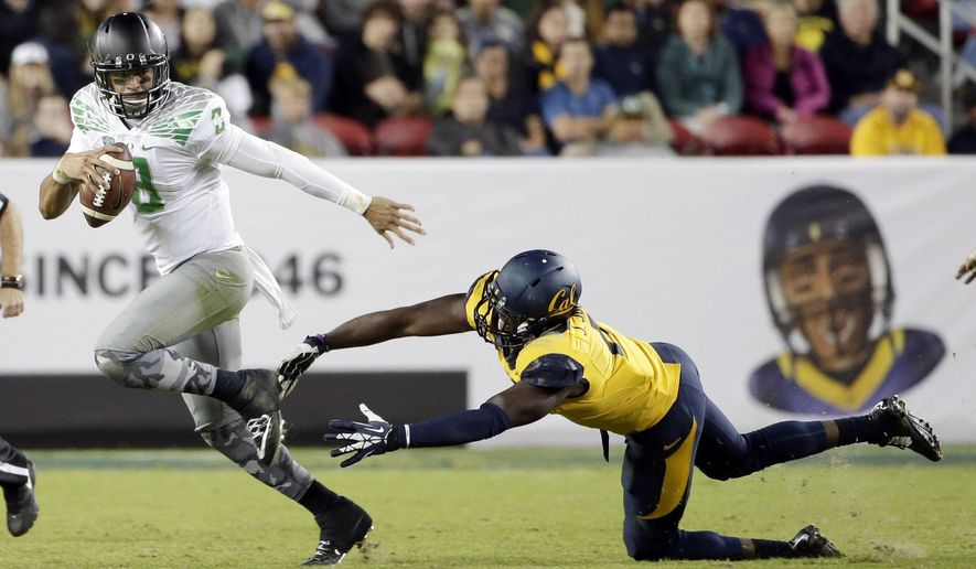 Oregon quarterback Marcus Mariota runs past California defensive end Jonathan Johnson during the second half of an NCAA college football game Friday, Oct. 24, 2014, in Santa Clara, Calif. (AP Photo/Marcio Jose Sanchez)