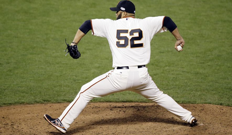 San Francisco Giants pitcher Yusmeiro Petit throws during the fourth inning of Game 4 of baseball's World Series against the Kansas City Royals Saturday, Oct. 25, 2014, in San Francisco. (AP Photo/Eric Risberg)