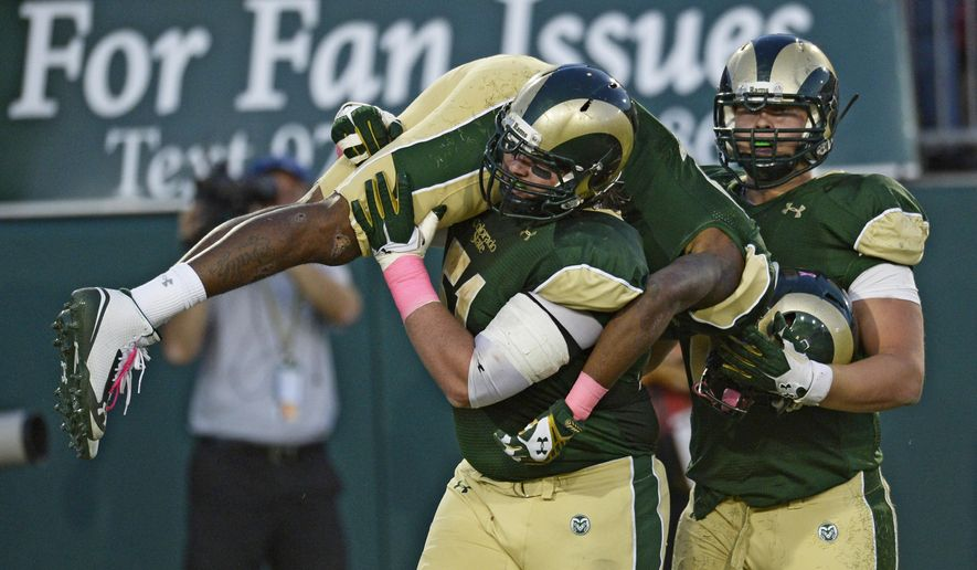 Colorado State  offensive lineman Ty Sambrailo (51), left, and Colorado State offensive lineman Sam Carlson (71), right, pick up and carry  wide receiver Rashard Higgins (82), in celebration after Higgins scored a touchdown against Wyoming during the second quarter of an NCAA college football game, Saturday, Oct. 25, 2014 in Fort Collins, Colo. (AP Photo/The Denver Post, Andy Cross) MAGS OUT; TV OUT; INTERNET OUT; NO SALES; NEW YORK POST OUT; NEW YORK DAILY NEWS OUT