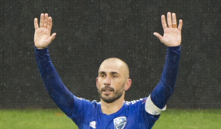 Montreal Impact's Marco Di Vaio celebrates after scoring against D.C. United during an MLS soccer game in Montreal, Saturday, Oct. 25, 2014. (AP Photo/The Canadian Press, Graham Hughes)