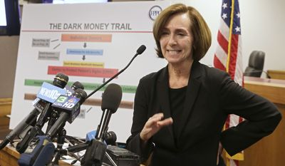 Ann Ravel, chairwoman of the California Fair Political Practices Commission, discusses the $1 million fine, the largest in its history, levied against two political action committees for campaign-reporting violations, during a news conference in Sacramento, Calif., Thursday, Oct. 24, 2013.  The FPPC also ordered two separate groups to pay the state's general fund the amount of money donated to them during the 2012 election cycle by the groups that were fined.  The Small Business Action Committee was ordered to pay $11 million while the California Future Fund for Free Markets  was ordered to pay $4 million. (AP Photo/Rich Pedroncelli)