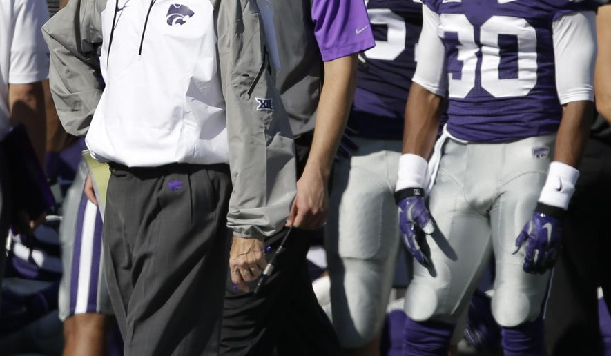 Kansas State head coach Bill Snyder paces the sidelines during the first half of an NCAA college football game against Texas in Manhattan, Kan., Saturday, Oct. 25, 2014. (AP Photo/Orlin Wagner)