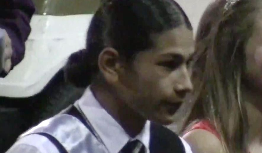 Student Jaylen Fryberg is seen during a homecoming celebration at Marysville-Pilchuck High School in Marysville, Wash., on Friday, Oct. 17, 2014, in this still frame made from video. Fryberg has been identified as the gunman who walked into his Seattle-area high school cafeteria on Friday and opened fire without shouting or arguing, killing one person and shooting several others in the head before turning the gun on himself, officials and witnesses said. (AP Photo/Jim McGauhey)