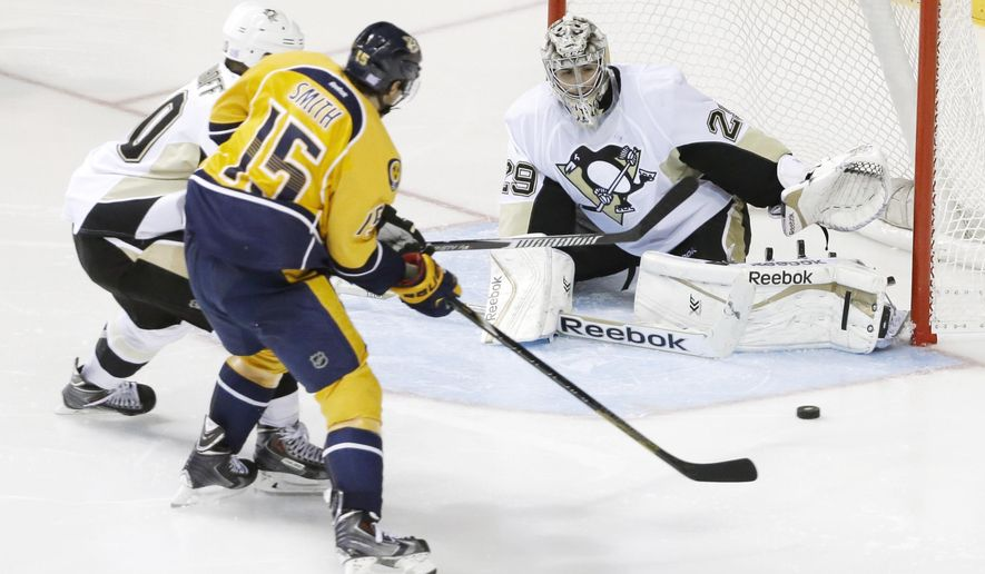 Pittsburgh Penguins goalie Marc-Andre Fleury (29) blocks a shot by Nashville Predators center Craig Smith (15) in the third period of an NHL hockey game Saturday, Oct. 25, 2014, in Nashville, Tenn. The Penguins won 3-0. (AP Photo/Mark Humphrey)