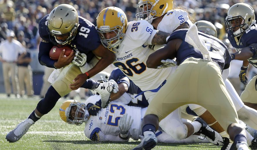Navy quarterback Keenan Reynolds, left, runs into the end zone for a touchdown past San Jose State linebacker Vince Buhagiar (36) in the first half of an NCAA college football game in Annapolis, Md., Saturday, Oct. 25, 2014. (AP Photo/Patrick Semansky)