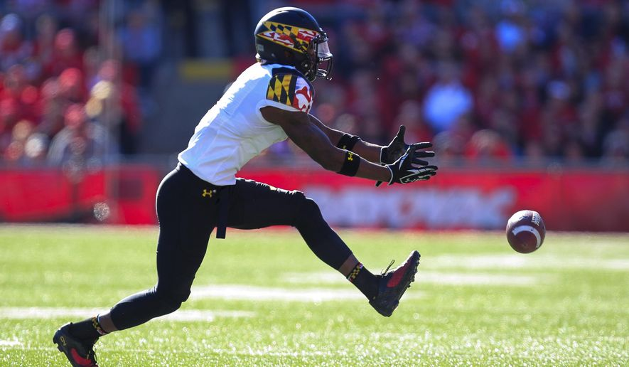 Maryland wide receiver Stefon Diggs (1) misses a pass against Wisconsin during the first half of an NCAA college football game Saturday, Oct. 25, 2014, in Madison, Wis. Wisconsin won 57-7. (AP Photo/Andy Manis)