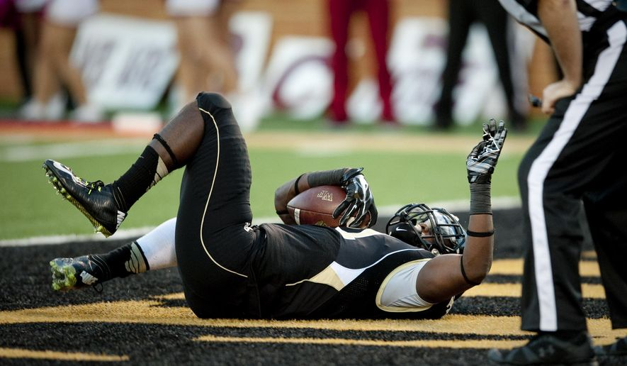 Wake Forest's Isaiah Robinson falls into the end zone to score a touchdown during the second half of an NCAA college football game against Boston College, in Winston-Salem, N.C. Saturday, Oct. 25, 2014. (AP Photo/Winston-Salem Journal, Lauren Carroll)