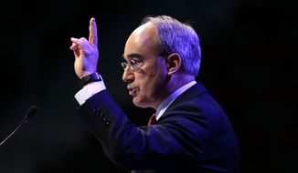 In this file photo made Saturday, April 26, 2014, then-Republican congressional candidate Bruce Poliquin speaks at the Maine Republican Convention in Bangor, Maine. (AP Photo/Robert F. Bukaty)