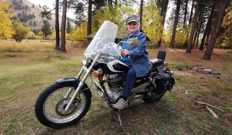 "Pauline ""Frankie"" Birnn of Darby hasn't let something as small as a few years get in the way of her lifelong love for riding motorcycles. The 86-year-old has logged in more than 600 miles on her Suzuki Savage this summer and fall. (AP Photo/Ravalli Republic, Perry Backus)"