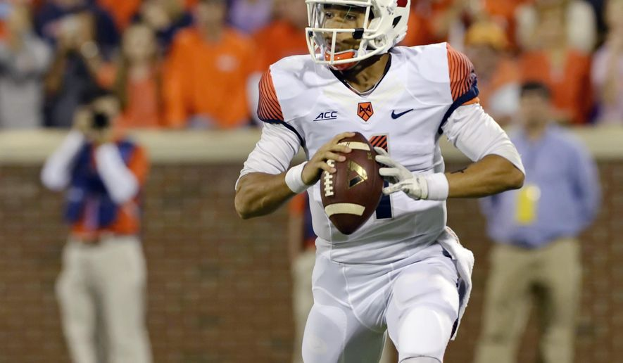 Syracuse quarterback AJ Long runs out of the pocket looking for receivers during the first half an NCAA college football game against Clemson in Clemson, S.C.,  Saturday, Oct. 25, 2014. (AP Photo/ Richard Shiro)