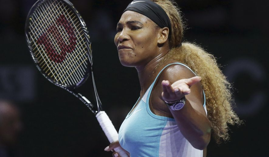 Serena Williams of the U.S. reacts during her singles final against Romania's Simona Halep at the WTA tennis finals in Singapore, Sunday, Oct. 26, 2014. (AP Photo/Mark Baker)