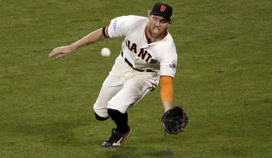 San Francisco Giants' Hunter Pence makes a diving catch for the out on a ball hit by Kansas City Royals' Lorenzo Cain during the ninth inning of Game 4 of baseball's World Series Saturday, Oct. 25, 2014, in San Francisco. (AP Photo/Marcio Jose Sanchez)