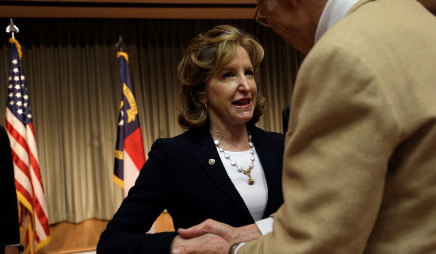 Sen. Kay Hagan, North Carolina Democrat, and Republican Thom Tillis, speaker of the state House, remain locked in a neck-and-neck race heading into the final week of the 2014 campaign. A Civitas poll last week showed them tied at 44 percent. (Associated Press)