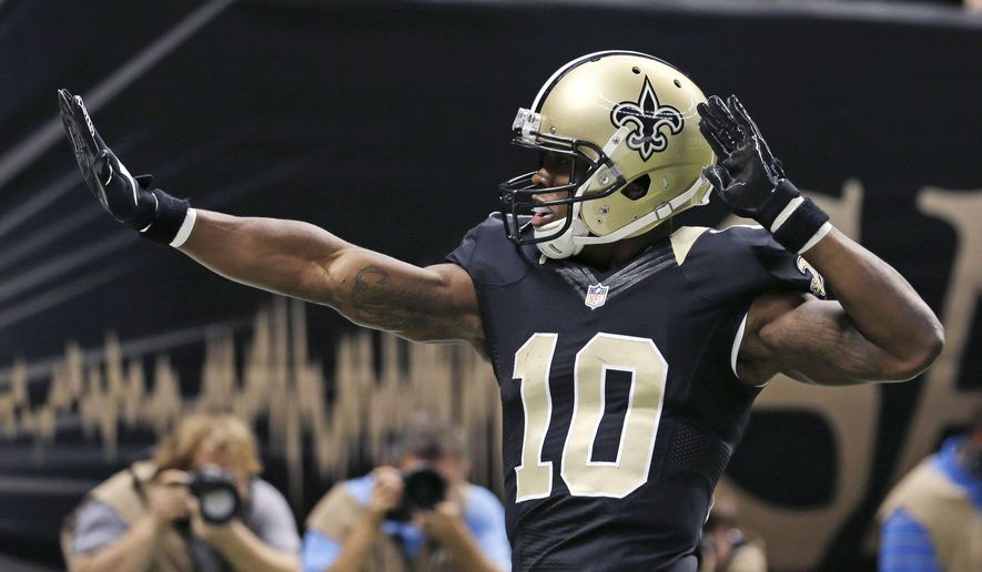 New Orleans Saints wide receiver Brandin Cooks (10) celebrates his touchdown in the first half of an NFL football game against the Green Bay Packers in New Orleans, Sunday, Oct. 26, 2014. (AP Photo/Bill Haber)