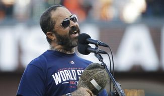 Recording artist Aaron Lewis performs the national anthem before Game 5 of baseball's World Series between the Kansas City Royals and the San Francisco Giants Sunday, Oct. 26, 2014, in San Francisco. (AP Photo/Matt Slocum)