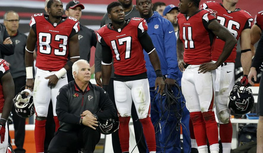 Atlanta Falcons head coach Mike Smith watches as Detroit Lions kicker Matt Prater (5) kicks the game winning field goal in the second half of the NFL football game at Wembley Stadium, London, Sunday, Oct. 26, 2014. The Loins won 22-21. (AP Photo/Matt Dunham)