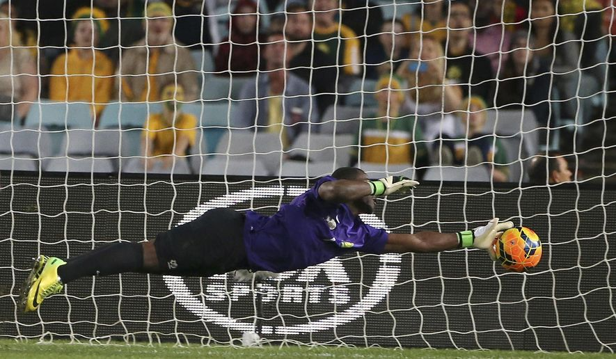 FILE- In this file photo dated Monday, May 26, 2014, South Africa's goalkeeper Senzo Robert Meyiwa makes a diving save against Australia during their friendly soccer match in Sydney.  According to reports Sunday Oct. 26, 2014, soccer club Orlando Pirates says 27-year old South Africa goalkeeper Senzo Meyiwa died during a shooting incident in South Africa.(AP Photo/Rick Rycroft, FILE)