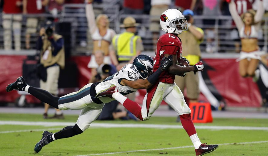 Arizona Cardinals wide receiver John Brown (12) scores a touchdown as Philadelphia Eagles cornerback Cary Williams (26) defends during the second half of an NFL football game, Sunday, Oct. 26, 2014, in Glendale, Ariz. (AP Photo/Rick Scuteri)