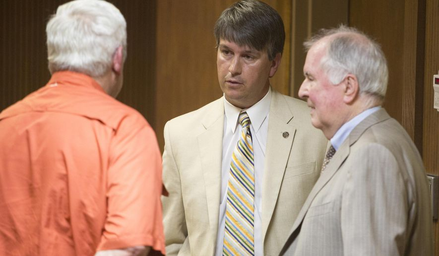 FILE - In a Tuesday, May 20, 2014 file photo, Republican state Rep. Barry Moore, center, of Enterprise, speaks with his lawyer, Bill Baxley, right, after a hearing requesting that the charges against him be dismissed, at the Lee County Justice Center in Opelika, Ala. Moore, of Enterprise, goes on trial Monday, Oct. 27, 2014, in Opelika, on perjury charges accusing him of making false statements to the grand jury In Lee County.  (AP Photo/Opelika-Auburn News, Albert Cesare, Pool,  File)